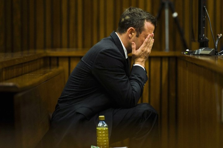 Oscar Pistorius vomited in to a bucket when he saw a graphic image of the body of Reeva Steenkamp in court today (Thursday)