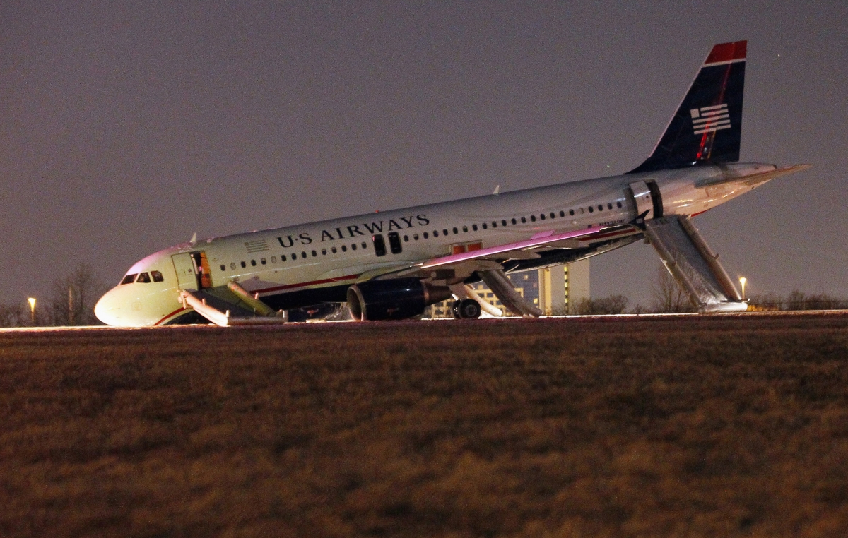 A US Airways plane with a collapsed nose is seen at Philadelphia International Airport March 13, 2014.