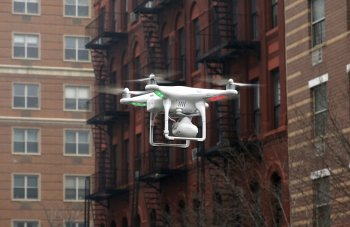 Could we one day get used to seeing helicopter drones fly around residential and city areas?