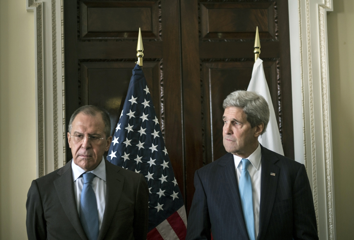 U.S. Secretary of State John Kerry (R) and Russia's Foreign Minister Sergei Lavrov stand together before their meeting at Winfield House, the home of the U.S. ambassador in London
