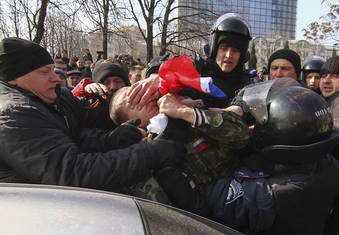 Police detain a pro-Russian protester at a rally in Donetsk.