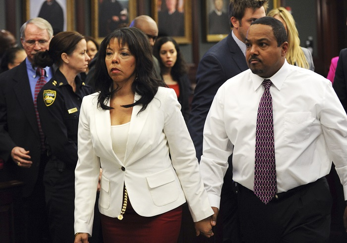 Jordan Davis' mother Lucia McBath leaves the courtroom with her husband, Curtis McBath.