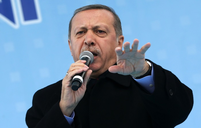 Turkish Prime Minister Recep Tayyip Erdogan addresses a crowed ahead of local elections on 30 March.