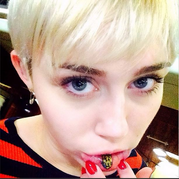 Miley Cyrus Gets Sad Kitty Tattoo