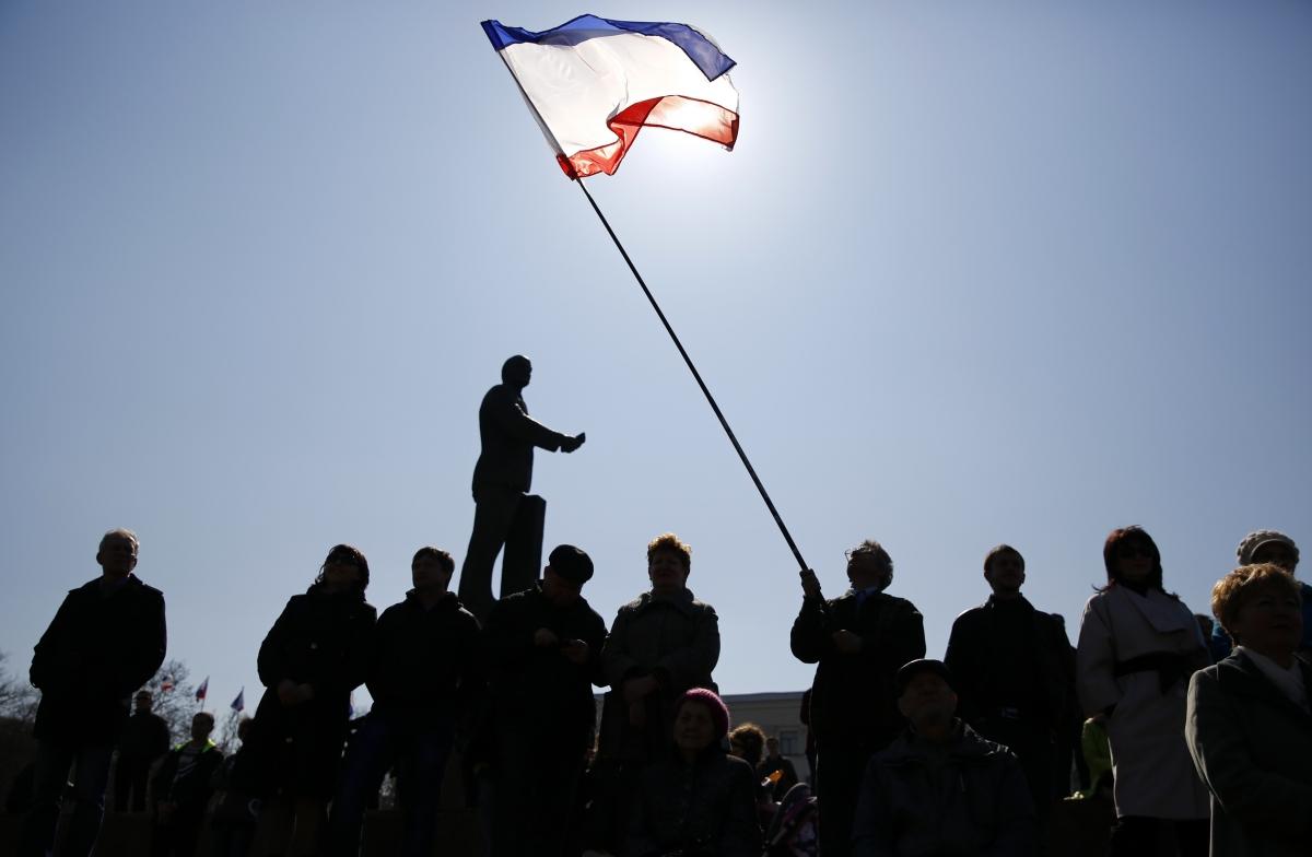 A man holds a Crimean flag