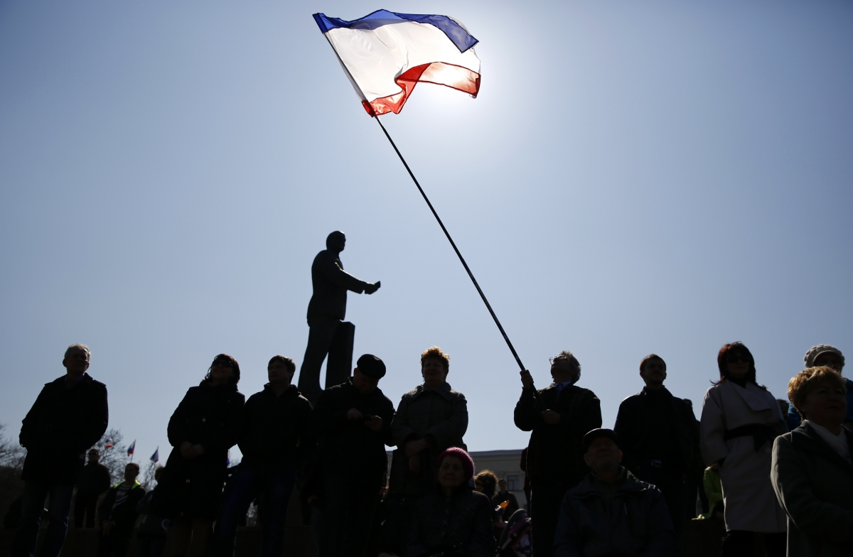 A man holds a Crimean flag