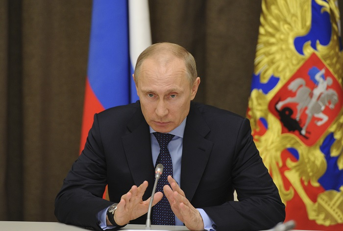 Russian President Vladimir Putin said Crimea's referendum fully complies with international law despite being roundly condemned by world leaders.