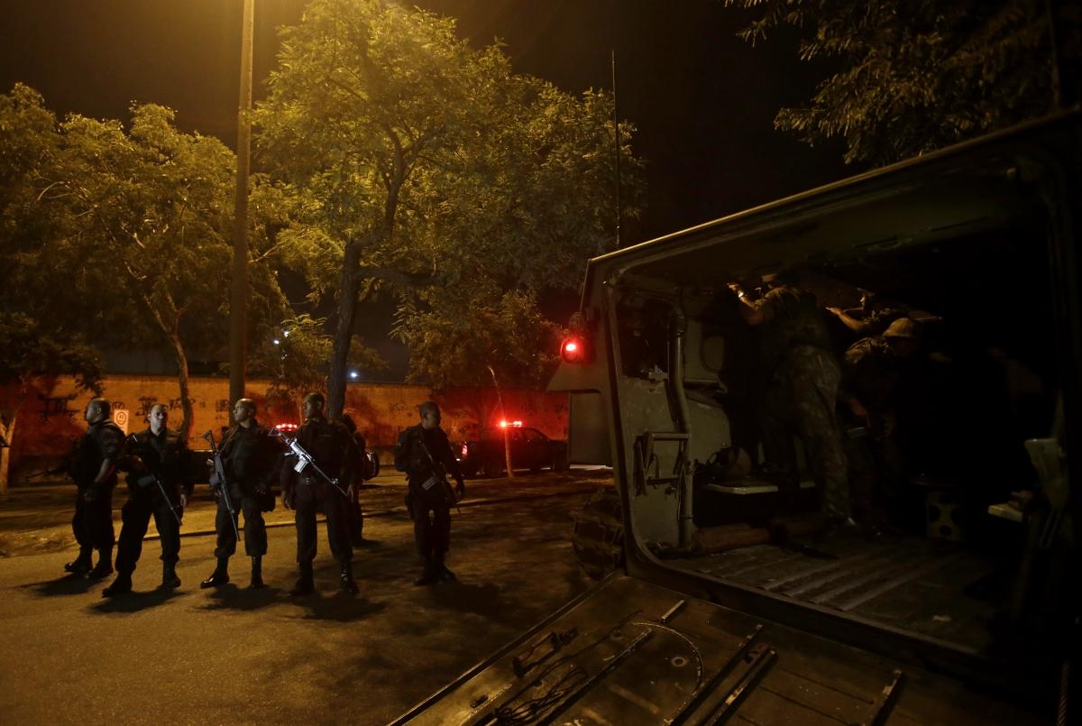 Members of the BOPE police unit patrol the favela of Parque Alegria in Rio De Janeiro.
