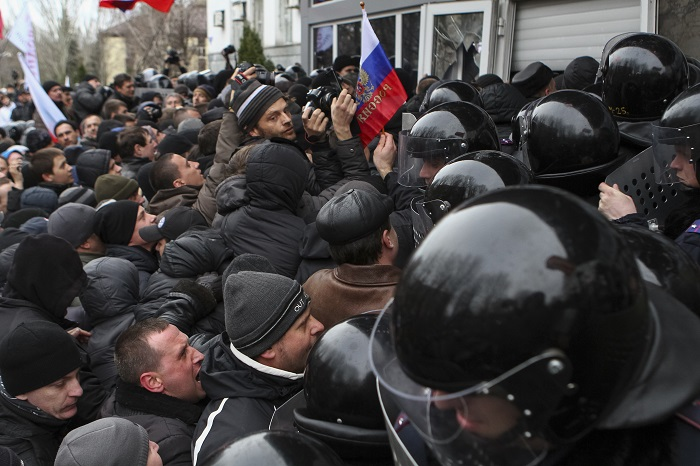 Pro-Russian demonstrators storm government buildings in Donetsk.