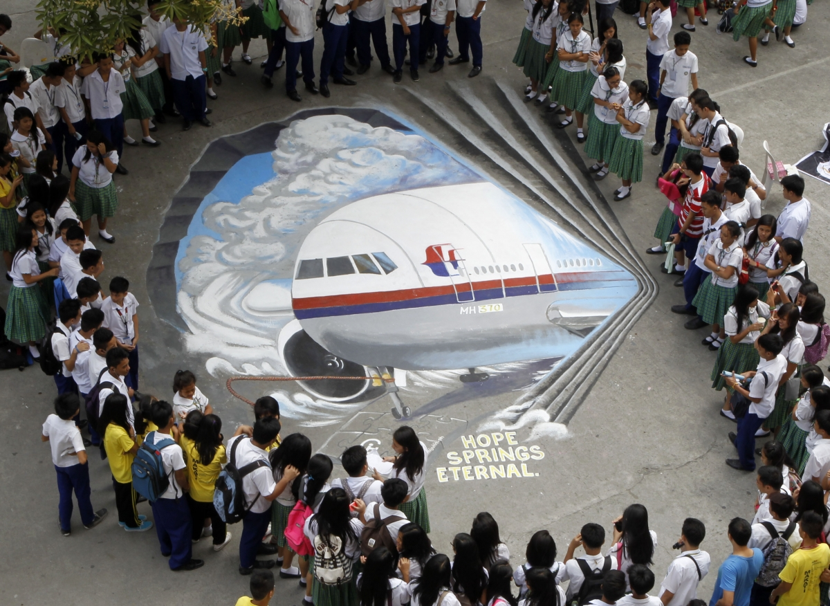 Missing Malaysia Airlines flight MH370 and probe on pilots' hijack