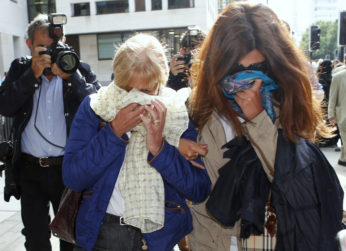 Italian Mafia Boss Domenico Rancadore AKA Marc Skinner: Ann (L) and Daniela Skinner, the wife and daughter of Domenico Rancadore, cover their faces as they leave Court in August 2013