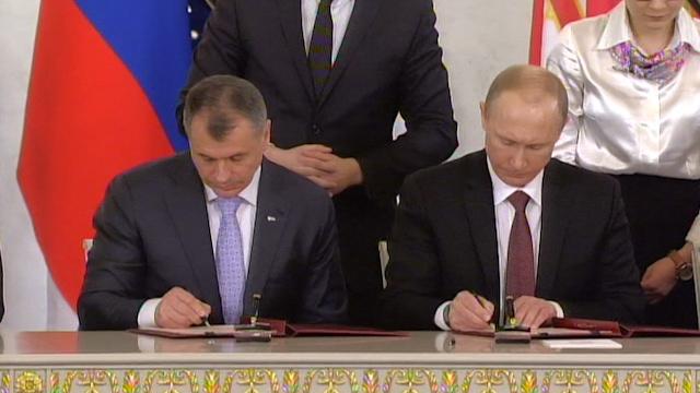 Putin and Crime Sign Treaty on Crimea Joining Russian