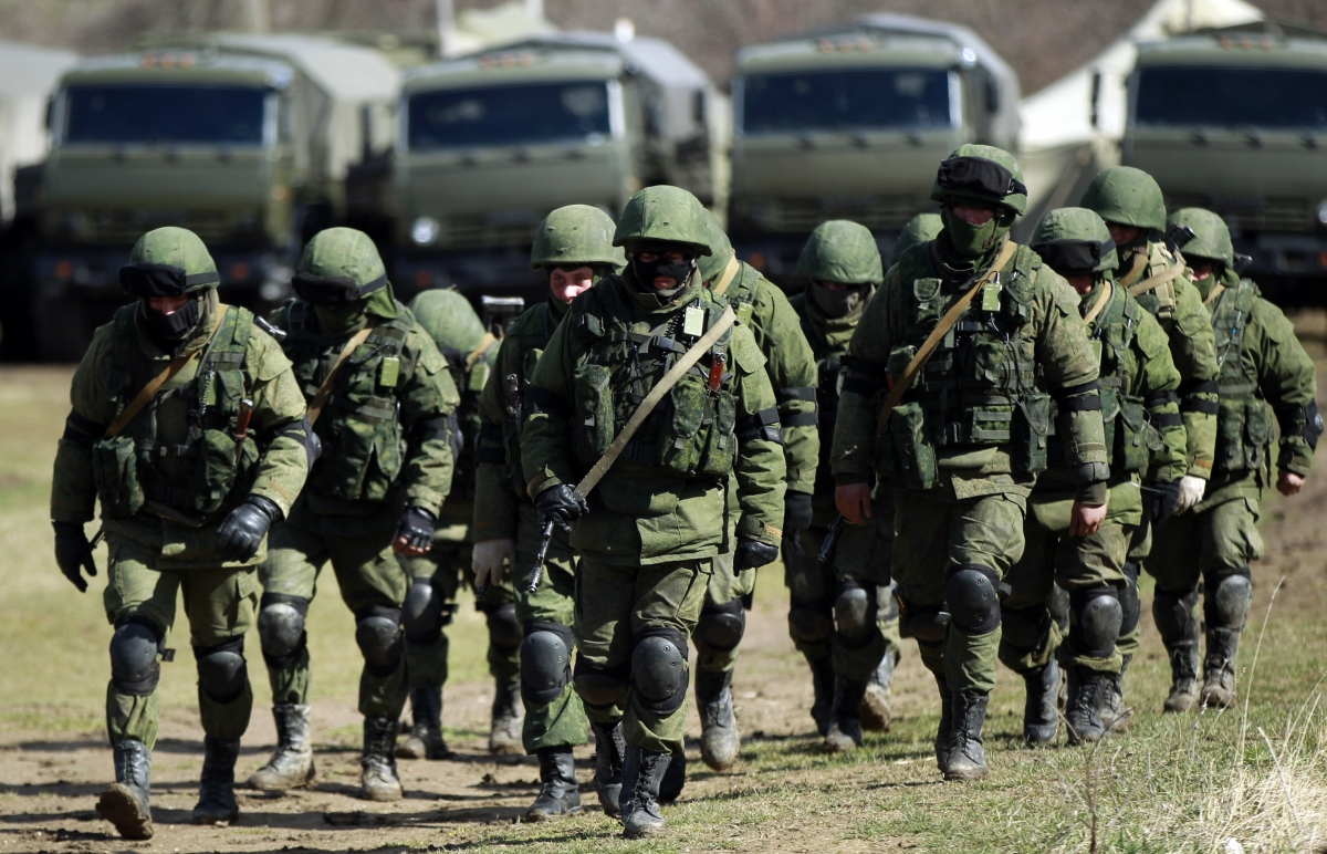 Armed men, believed to be Russians, march at their camp near the Ukrainian military base in Perevalnoye outside Simferopol