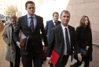 Evans arrives at Preston Crown Court for his trial with his legal team.