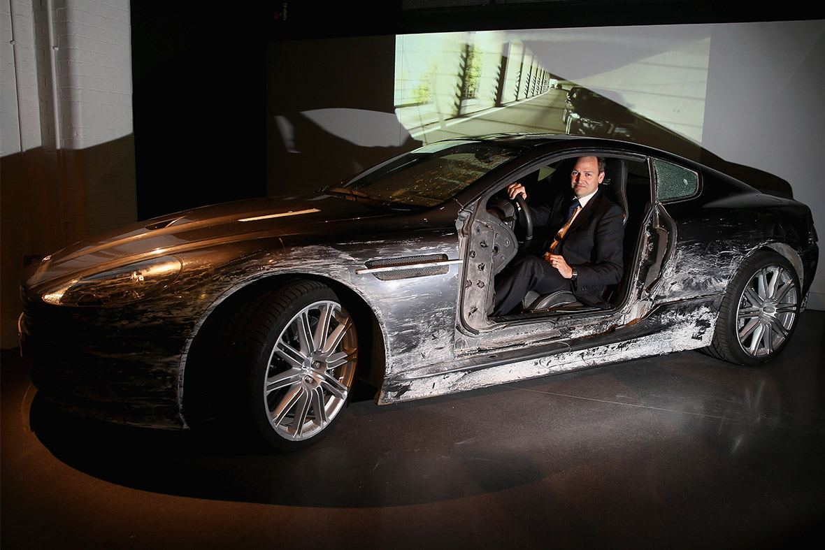 Ben Collins, stunt driver for Daniel Craig, poses with the Aston Martin DBS from Quantum of Solace