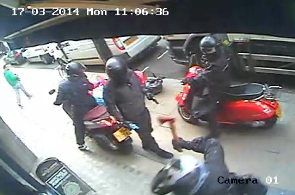 Moped Gang Ram Luxury Watch Shop Armed With Axe