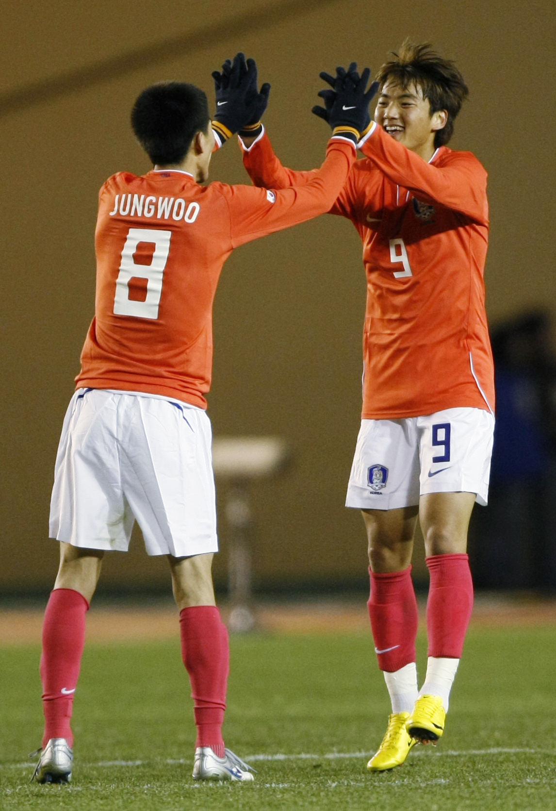 South Korea's Lee Seung-yeoul (R) celebrates with teammate Kim Jung-woo after scoring a goal against Hong Kong during their East Asian Championship soccer match in Tokyo February 7, 2010.