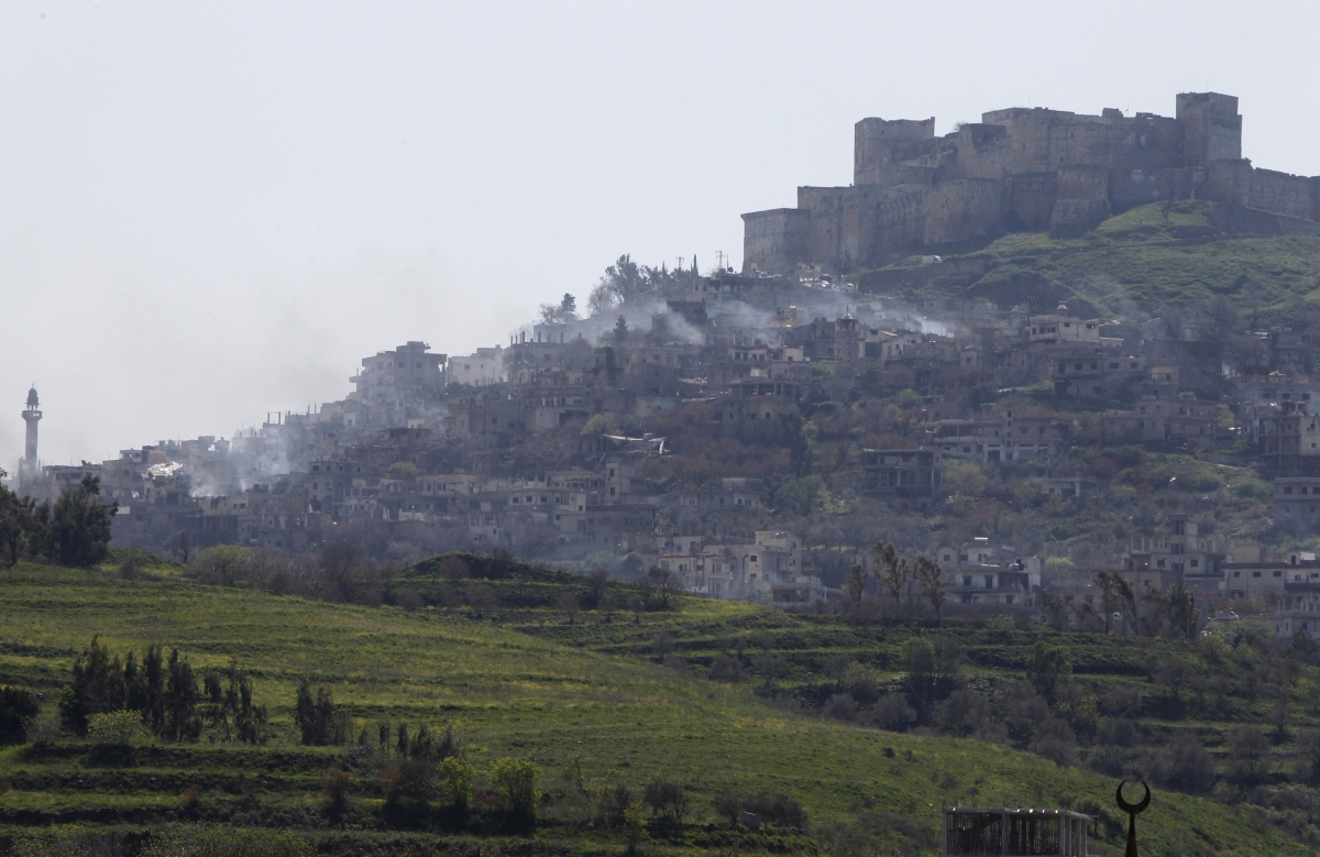 Smoke emerges from the village surrounding Krak des Chevaliers following fighting bwteen pro-government and rebel forces on Thursday.