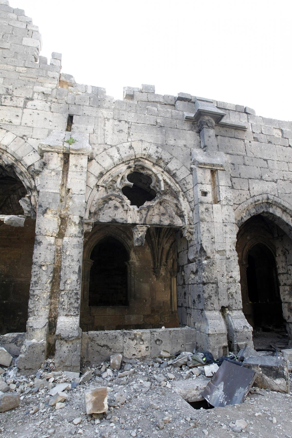 Bullet holes line the walls inside Krak des Chevaliers.