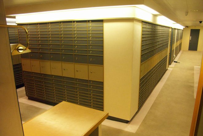 Vault of safes in Park Lane, London, were found to have stashed cash, weapons and drugs.