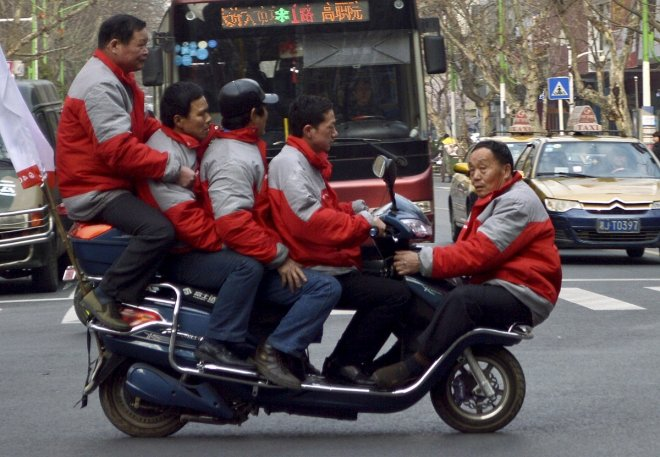 Men on scooter