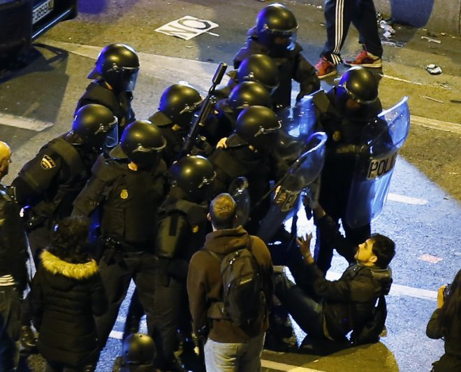 Riot police used rubber bullets and charged protestors at an anti-austerity march in Madrid