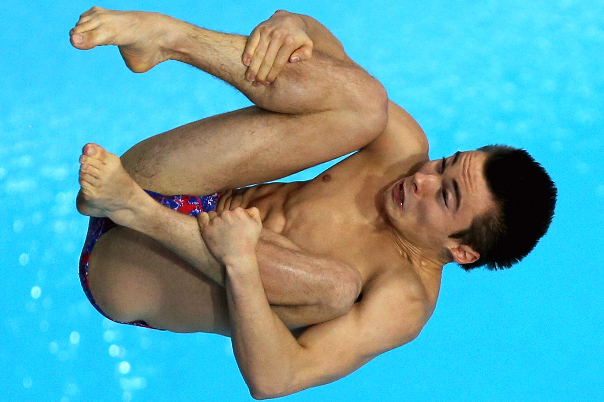 Daniel Goodfellow of Great Britain dives in the Mens 10m Platform semi final