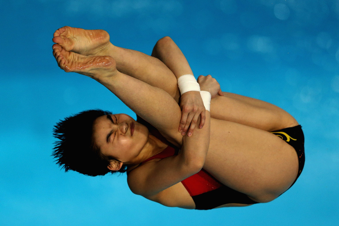 Huixia Liu of China dives in the Womens 10m Platform final