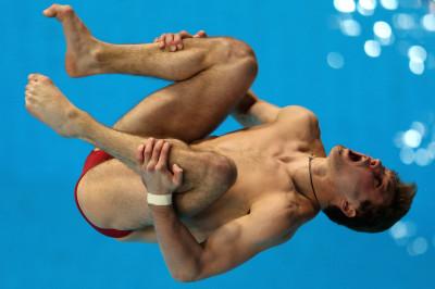 Oleksandr Bondar of Ukraine dives in the Mens 10m Platform final