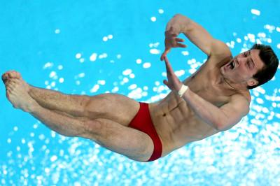 Oleksandr Bondar of Ukraine dives in the Mens 10m Platform semi final