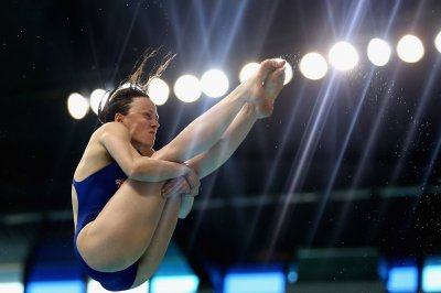 Rebbecca Gallantree of Great Britain dives in the Womens 3m Springboard final