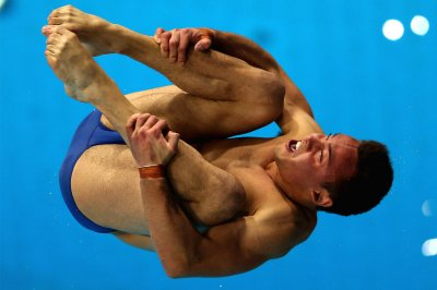Tom Daley of Great Britain dives in the Mens 10m Platform final