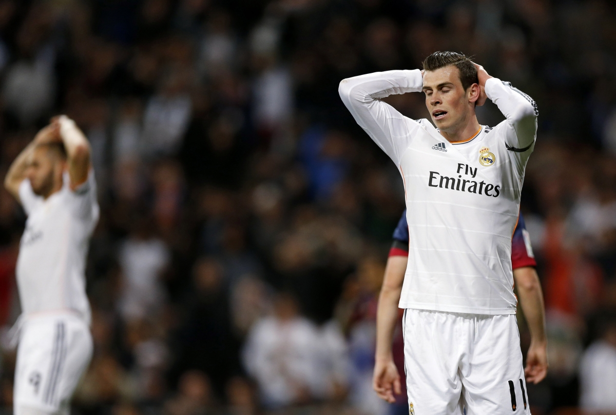 Real Madrid's Gareth Bale reacts after Barcelona won La Liga's second 'Clasico' soccer match of the season at Santiago Bernabeu stadium in Madrid March 23, 2014.