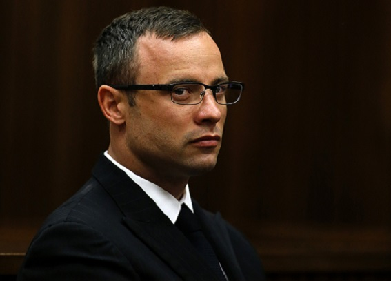 Oscar Pistorius contains his emotions as his murder trial for killing Reeva Steenkamp is adjourned in Pretoria