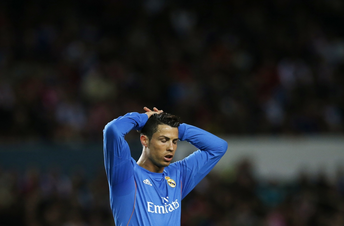 Real Madrid's Cristiano Ronaldo reacts during their Spanish First Division soccer match against Sevilla at Ramon Sanchez Pizjuan stadium in Seville March 26, 2014.