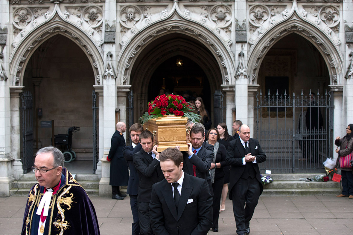 The sons and grandsons of Tony Benn carry his coffin out of St Margarets Church following his funeral
