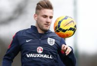 England\'s Luke Shaw controls the ball during a team training session at the Tottenham Hotspur training ground in Enfield, north of London, March 3, 2014.