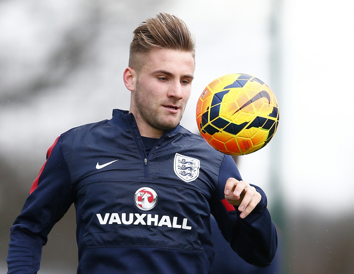England's Luke Shaw controls the ball during a team training session at the Tottenham Hotspur training ground in Enfield, north of London, March 3, 2014.