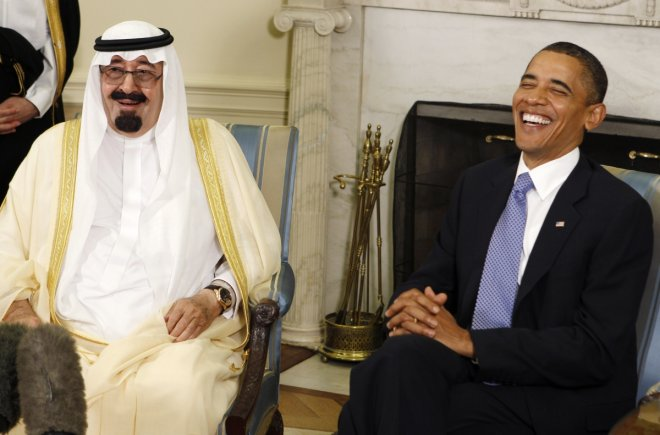 U.S. President Barack Obama (R) laughs as he meets with King Abdullah of Saudi Arabia