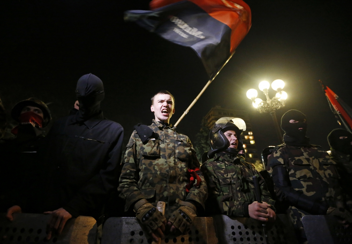 Activists of the Right Sector movement and their supporters gather outside the parliament