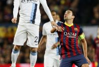 Manchester City\'s David Silva (L) heads the ball next to Barcelona\'s Xavi during their Champions League last 16 second leg soccer match at Camp Nou stadium in Barcelona March 12, 2014.