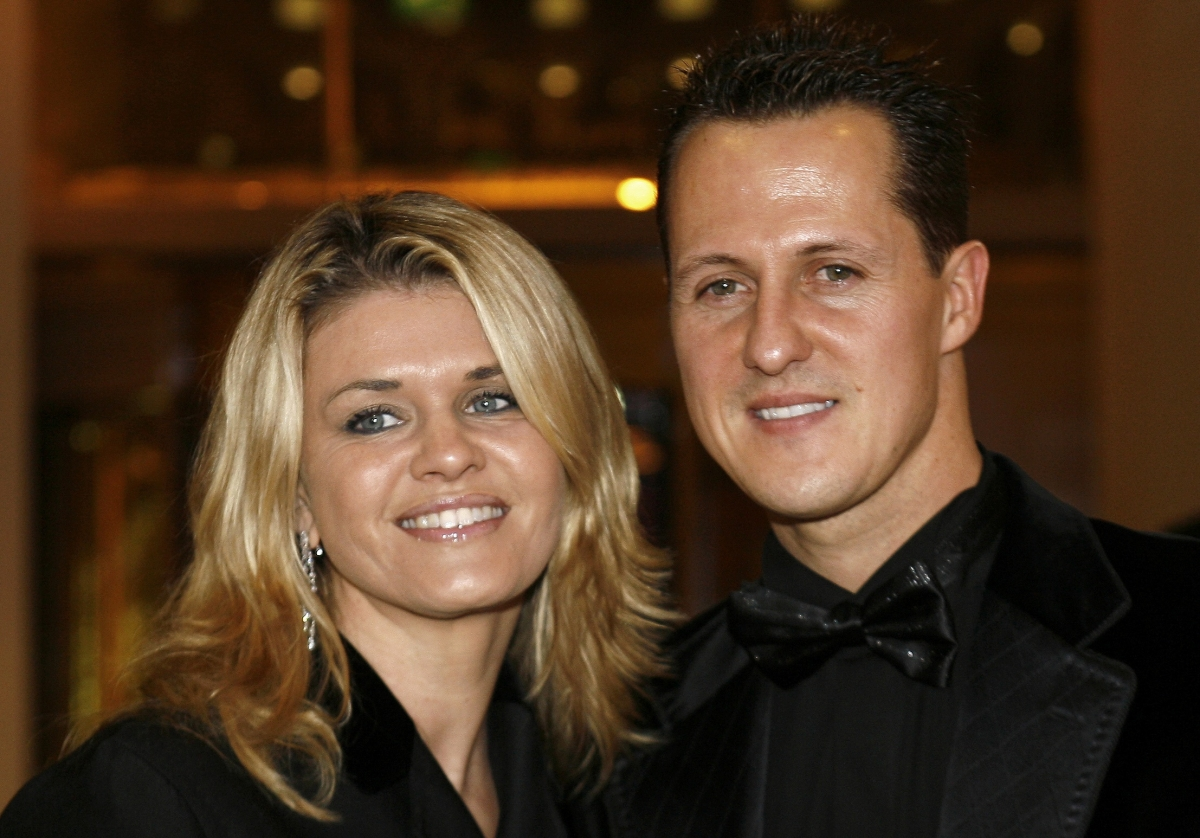 Michael Schumacher (r) and wife Corinna face him learning how to walk and talk again, warns Cambridge University professor