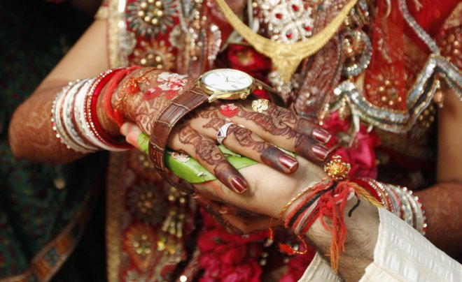 A couple exchange vows in the western Indian city of Ahmedabad.