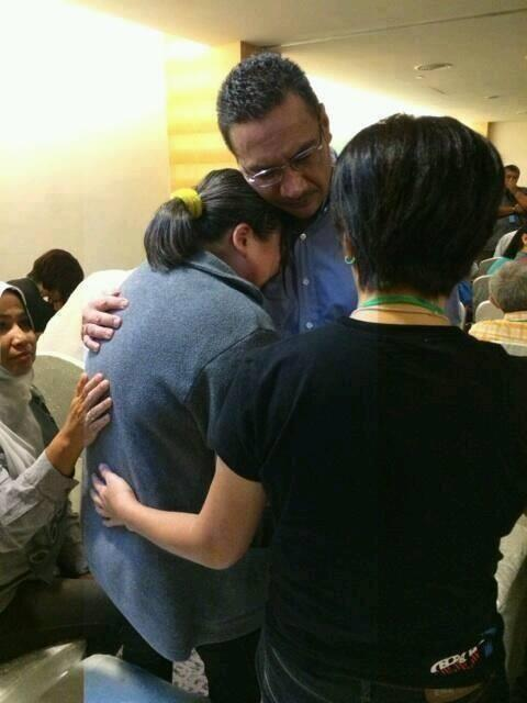 Hussein comforts relatives