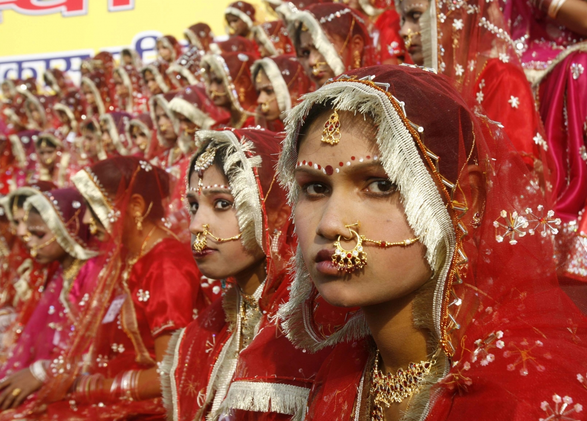 Child brides prepare for their wedding in India , where dowry deaths have risen