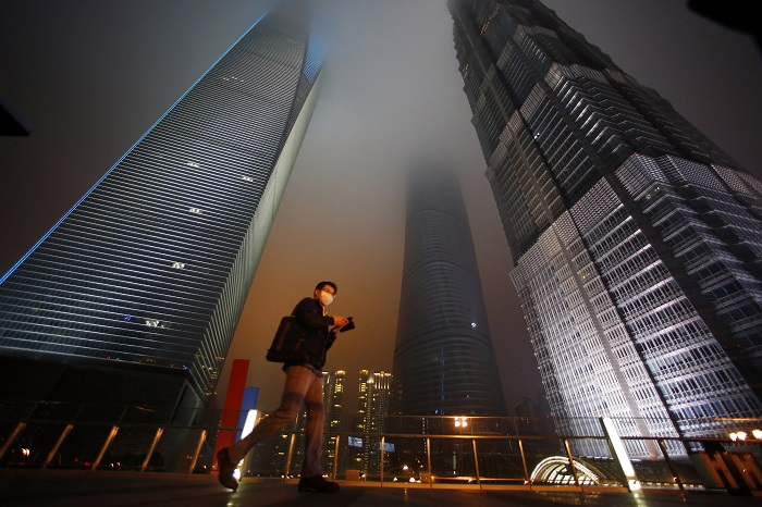 Skyscrapers in Shanghai's financial district of Pudong are unrecognisable with all their lights switched off for the annual Earth Hour event.