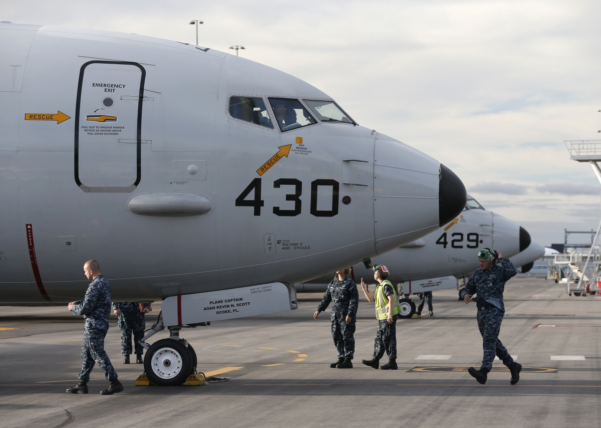 A U.S. Navy P8 Poseidon aircraft returns from a search flight for Malaysia Airlines flight MH370 over the Indian Ocean