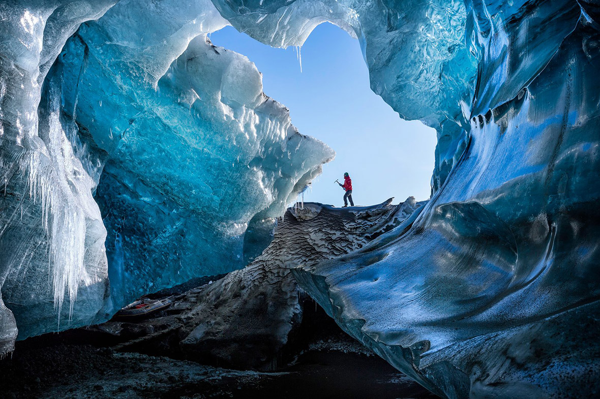 A local guide arriving at a remote ice cave in southeast Iceland