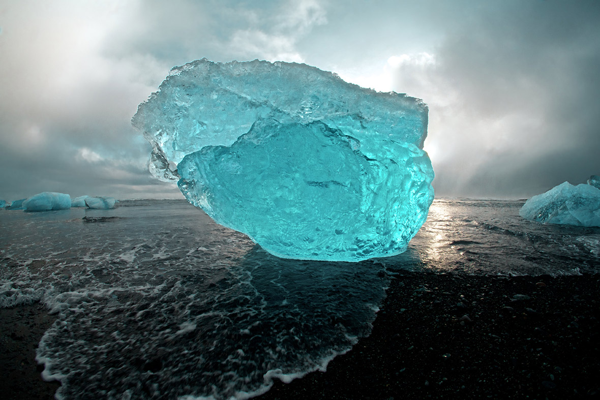 Huge iceberg sculptures on a volcanic black beach on the Jkulsrln lagoon in Iceland