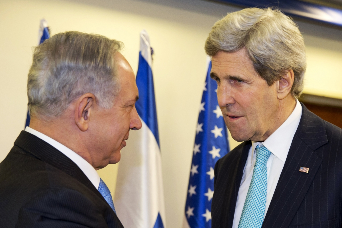 Israeli Prime Minister Benjamin Netanyahu (L) meets with U.S. Secretary of State John Kerry as they meet in Jerusalem